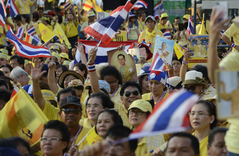High Angle View Of People With Picture Frame And Thai Flags At Event