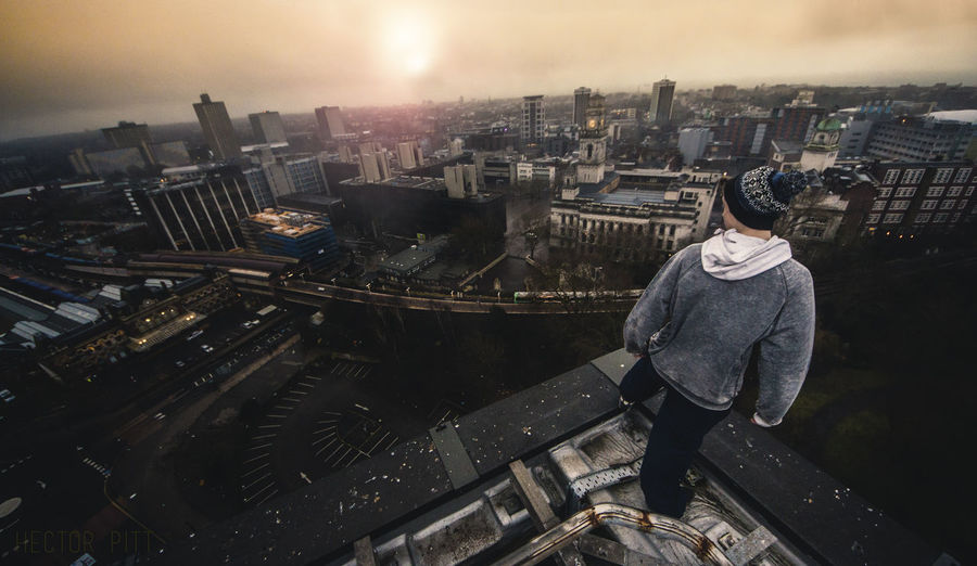 High angle view of man with cityscape in background