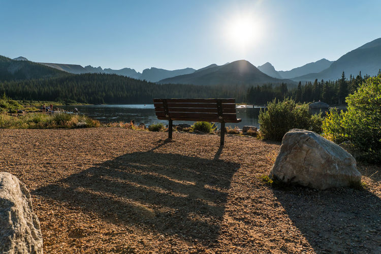 Nature No People Sky Beauty In Nature Colorado Boulder Colorado Rocky Mountains Mountain Tranquility Tranquil Scene Scenics - Nature Sunlight Water Mountain Range Idyllic Non-urban Scene Sun Plant Day Environment Lake Land Outdoors Lens Flare