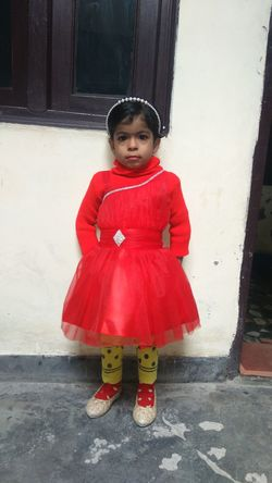 My babygirl in new dress. Childhood Children Only One Person Child One Girl Only Full Length Innocence Red Portrait Looking At Camera Standing Girls People Front View Rubber Boot Outdoors Human Body Part Smiling Gap Toothed Day