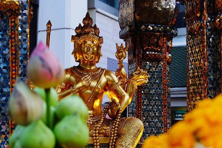Gilded god statue in temple