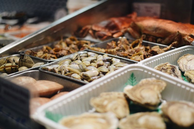 Close-up of fresh seafood in containers at market stall