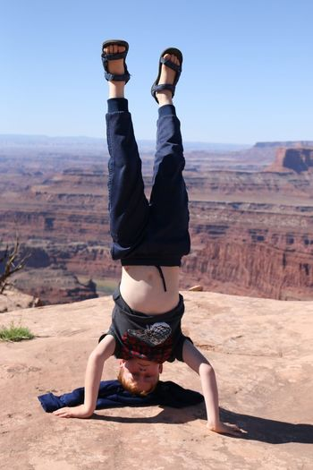 doing cool things in cool places. Canyonlands National Park Canyonlands National Park, Utah Head Stand Headstand School Age Child Vista From My Point Of View EyeEm Selects Desert Sports Clothing Full Length Exercising Healthy Lifestyle Flexibility Rock - Object Athleticism