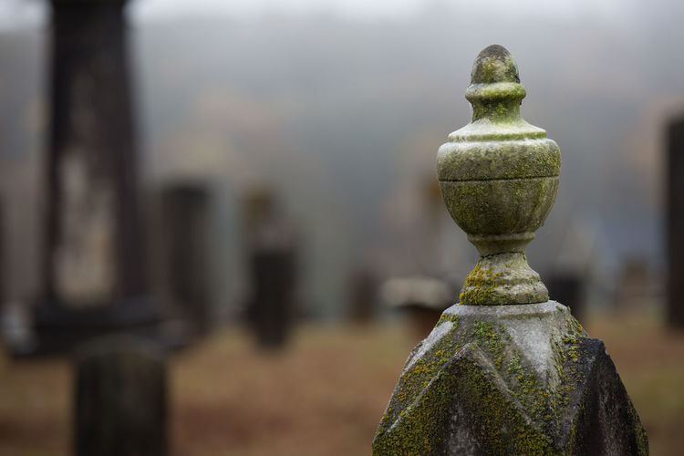 Cropped Image Of Moss On Stone Pole In Graveyard