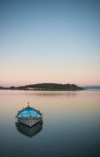 Boat in sea against clear sky during sunrise, méditerranéen sea, côte d azur