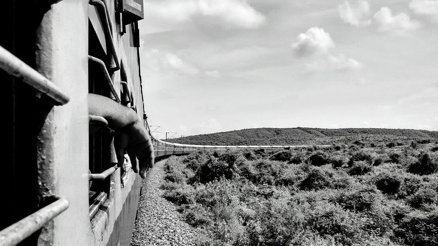 In a far away land, a guy picks and leave for nowwhere ....Cloud - Sky Sky EyeEmNewHere Bnw Photography Picoftheday Bnw_collection Photography Naturelovers Nature_collection Bnw Teavel Destination Travel Freshness Tranquility Summer Wanderlust Outdoors Human Body Part