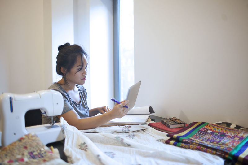 Young woman working on a tablet pc