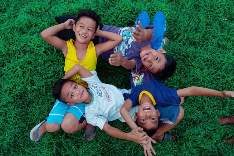 Boys Cheerful Child Childhood Directly Above Elementary Age Enjoyment EyeEm Gallery Eyeem Philippines Field Fun Girls Grass Happiness High Angle View Leisure Activity Lifestyles Looking At Camera Lying Down Lying On Back Outdoors Portrait Real People Smiling Togetherness