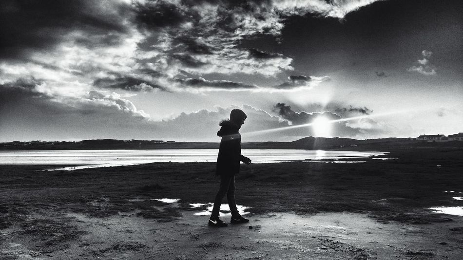 noon Blackandwhite Blackandwhite Photography Backlight After The Rain After The Storm Full Length One Person Beach Water Standing Sea Real People Cloud - Sky Sky