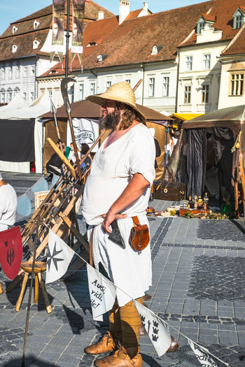 Man standing by street market in city
