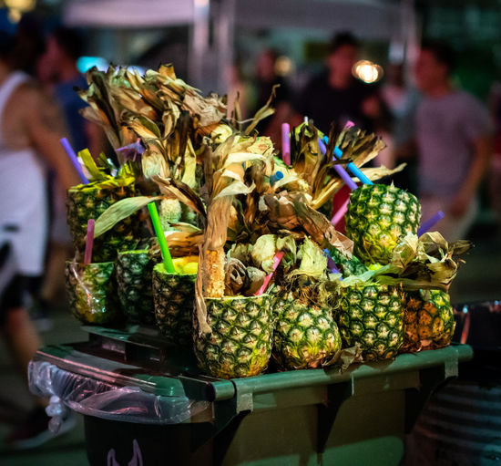 Colourful Crowds Green Color Market Pineapple Trash Close-up Compost Crowded Display Drink Fruit Garbage Night Organic Pile Rubber Straws Street Festival Street Food Tasty Tower Tropical Climate Umbrella Waste