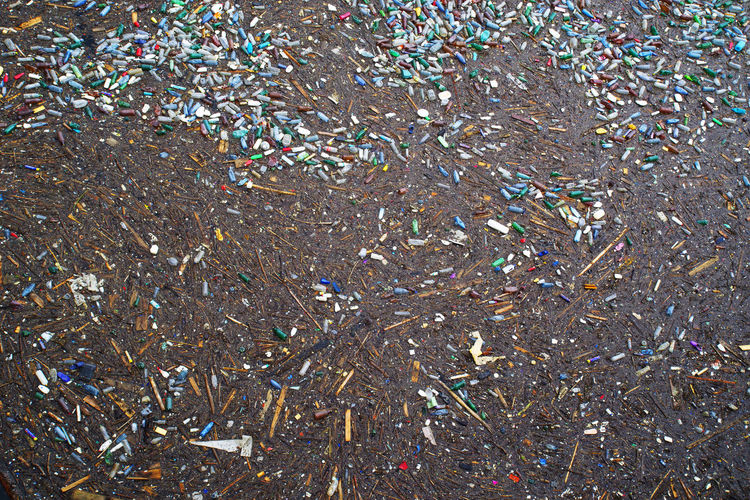 High angle view of garbage on glass