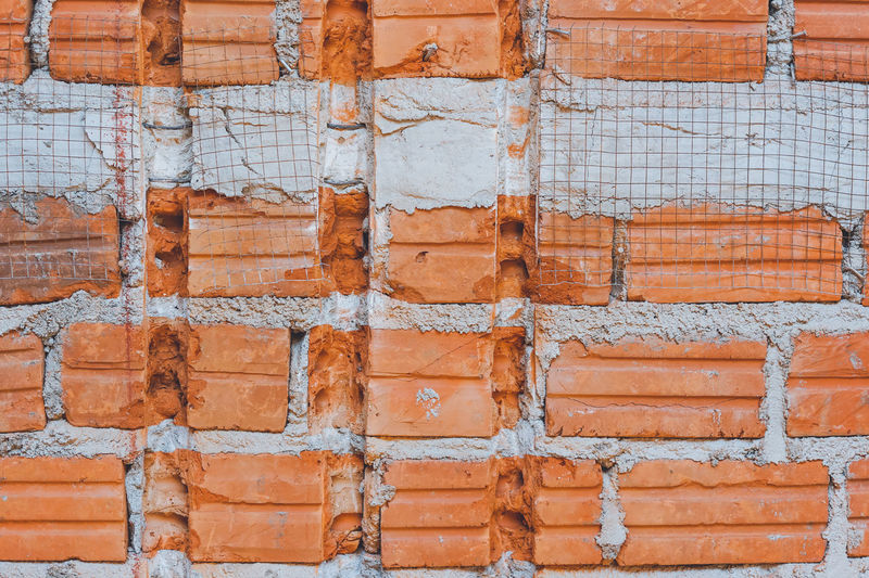 Brick wall in construction site Abstract Photography Brick Wall Cement Floor Cement Wall Construction Construction Site Hole In The Wall Under Construction... Wall Wall Art Abstract Brick Brick Building Brick Texture Brick Wall Background Bricks Built Structure Cement Concrete Concrete Wall Construction Work Hole Texure Wall - Building Feature Walls