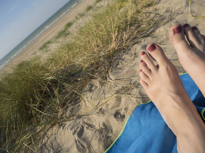 Beach Life Nail Polish Nature Relaxing Vacations Feet Human Body Part Lifestyles Sand Sand Dune Sea Water