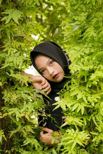 Portrait Of Young Woman In Tree