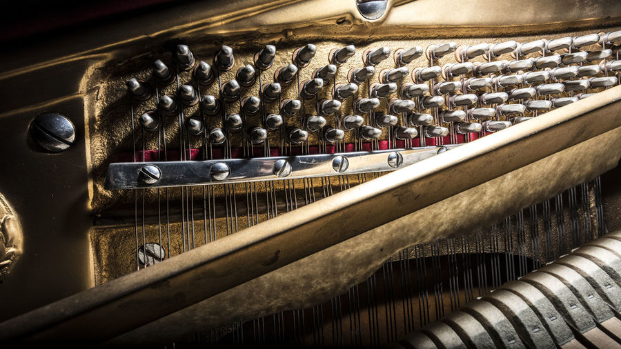 inside a piano close up Piano Inside Wooden Mechanism Musical Instrument Musical Equipment Tune Strings Hammer Man Made Object In A Row Multitude Large Group Of Objects Musical Notes Felt Design Structure Complexity Order Fragility Delicacy Performance Band Classical Music Orchestra