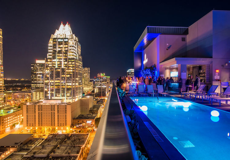 At the top of Austin Top Floor Open Pool Yellow Hotel Blue Architecture Building Building Exterior Built Structure City Cityscape Dusk Illuminated Luxury Modern Nature Night No People Office Building Exterior Pool Sky Skyscraper Swimming Pool Travel Destinations Water