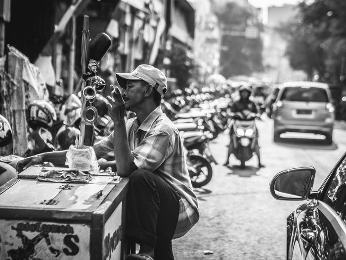 enjoying a bud of cigar Streetphotography Street Photography Streetvendor Old Oldman Oldmanportrait People People Photography Black And White Photography Black And White Blackandwhite Photography Blackandwhite The Street Photographer - 2018 EyeEm Awards City Men Car City Life Street City Street Crowd Road Traffic
