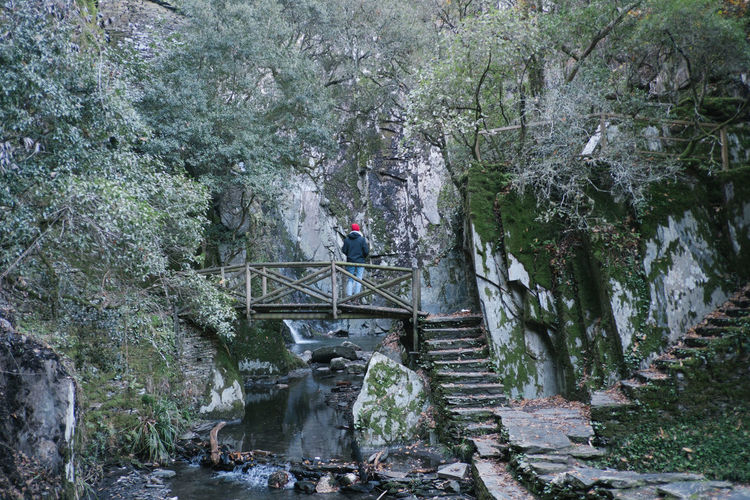 Adventure Backpack Beauty In Nature Bridge - Man Made Structure Climbing Day Footbridge Forest Full Length Hiking Leisure Activity Lifestyles Manteigas Men Mountain Nature One Person Outdoors Real People River Rock - Object Scenics Steps Tree Waterfall Women