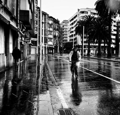 City Water Wet Street Outdoors City Life People Blackandwhite Photography Black And White Photography Black And White Collection  Bicycle Bycicle Rider Bicycling Bicyclist