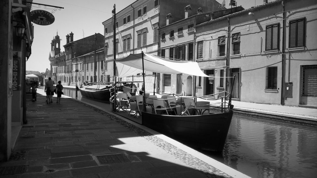 Black And White Lagoon Water Ship Comacchio Architecture Building Exterior Built Structure Transportation Water City Mode Of Transport Residential Building Street Light City Life Travel Destinations Canal Person Day Outdoors Old Town Sky Tourism