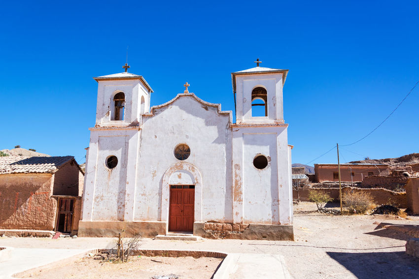 White old historic church in the small town of Chacopampa near Tupiza, Bolivia Andean Andes Beauty Bolivia Canyon Church Color Colorful Country Countryside Desert Formation Full Hills Mountains Nature Old Remote South America Town Travel TUPIZA Valley Village White