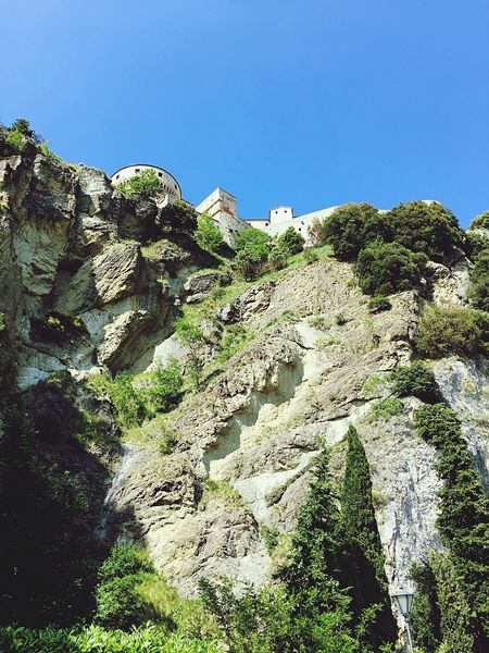 Clear Sky Rock - Object Nature Day Outdoors Blue No People Cliff Low Angle View Mountain Beauty In Nature Tree Sky San Leo Montefeltro Castle