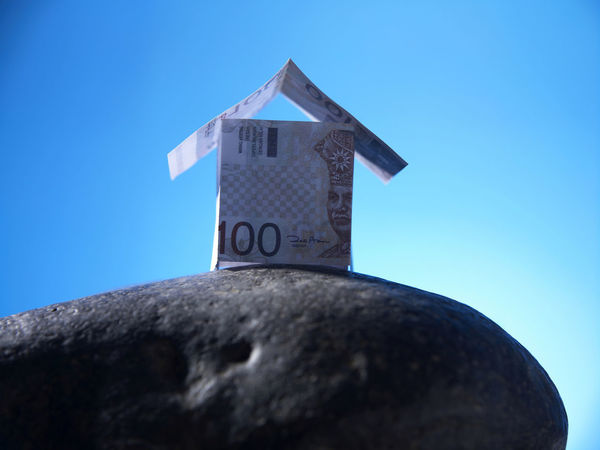 financial item cash Currency House Shape Architecture Blue Built Structure Cash Clear Sky Dollar Expenses Finance Guidance House Investment Low Angle View Model House Money No People Property Real Estate Savings Wealth