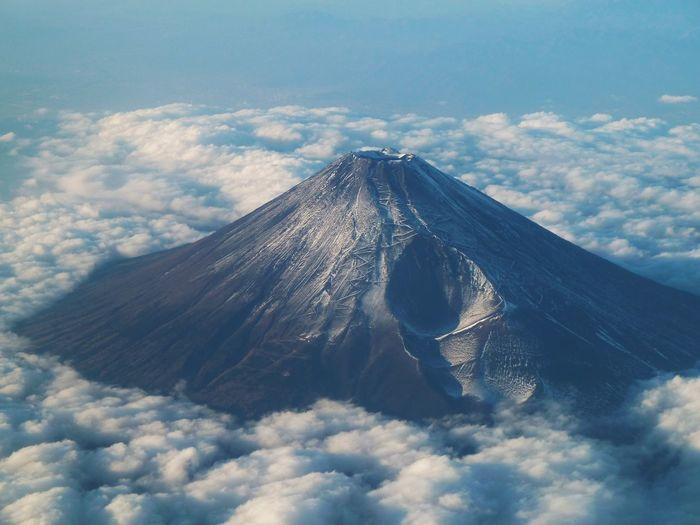 Idyllic shot of mountain amidst clouds