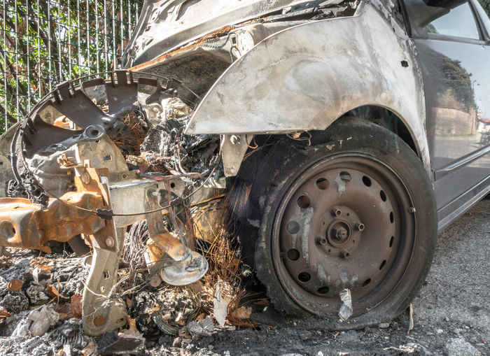 Outdoor Abandoned Accident Auto Automobile Black Blaze Broken Burn Burning Burnt Car Concepts Crash Crime Damage Danger Dangerous Day Destruction Disaster Engine Exploding Explosion Exterior Fire Flame Fuel Heat Highway Industry Inferno Insurance Metal Motor Part Photography Power Retro Road Rusty Safety Smoke Transport Transportation Vehicle