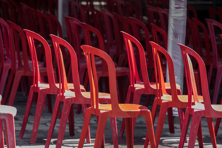 red chairs waiting for the prayers Red Seat Chair No People Absence In A Row Empty Repetition Arrangement Illuminated Side By Side Restaurant Architecture Business Abundance Nature Outdoors Place Of Worship Religion Plastic Setting EyeEm Best Shots Eye Em Gallery Eye Em Around The World Eye Em Best Edits