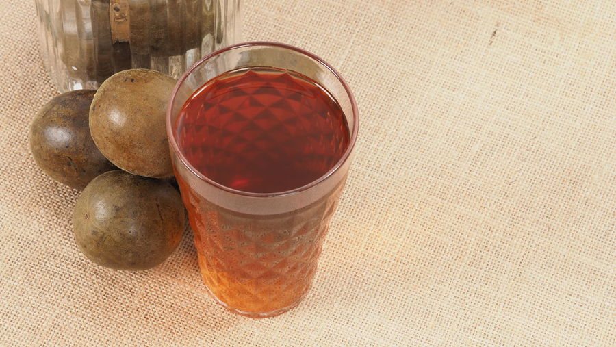 High angle view of drink in glass on table