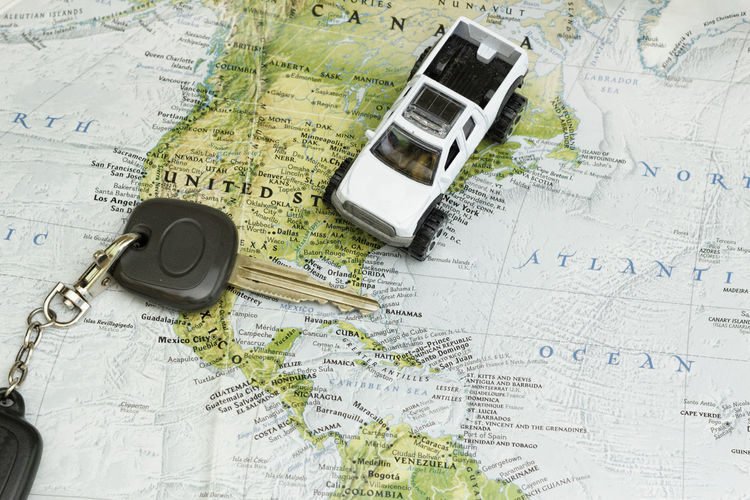 Car key and a toy truck on the world map Toy Truck Car Key Key Map World Map Car Concept Conceptual Travel Vacation Trip Plan Holiday Explore Humanitarian Transportation Close-up Topography Globe