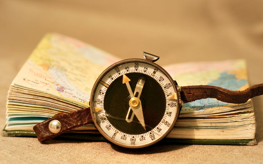 Adventure Close-up Currency Day Direction Indoors  Minute Hand Navigational Compass No People Old-fashioned Pocket Watch Time Watch