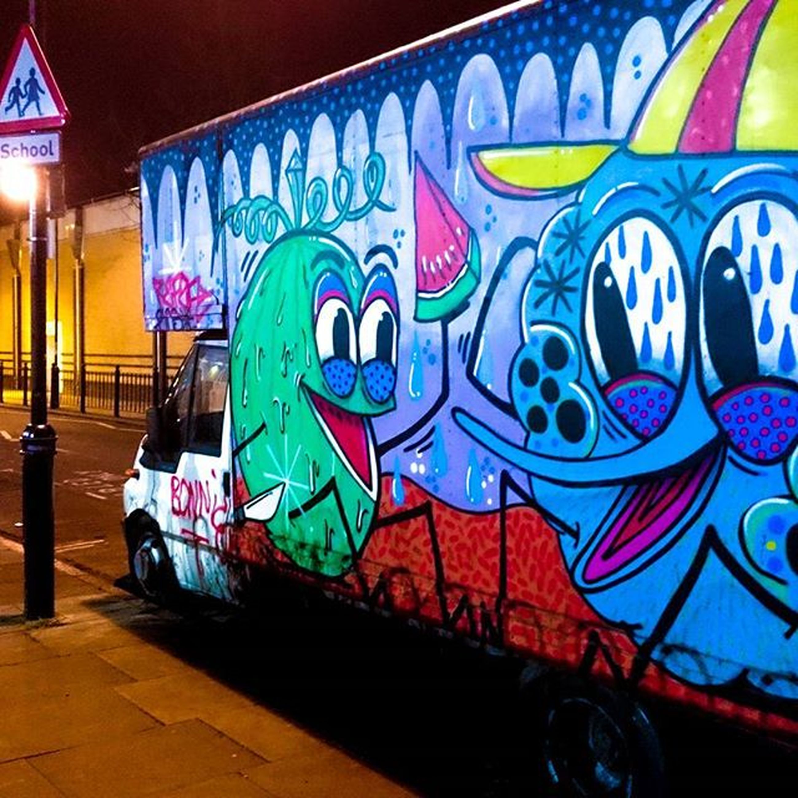multi colored, illuminated, transportation, graffiti, built structure, architecture, night, indoors, street, mode of transport, land vehicle, yellow, art, blue, art and craft, creativity, no people, wall - building feature, car, building exterior