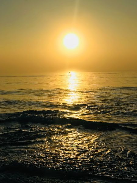 Sunset Jeff Woytovich Sunset Sea Beauty In Nature Sun Scenics Horizon Over Water Nature Water Sunlight Tranquil Scene Orange Color Tranquility Idyllic Reflection Outdoors Silhouette No People Beach Sky Wave