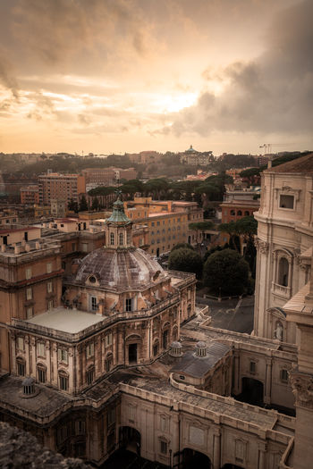 Behind St Peter's Square Architecture Building Building Exterior Built Structure City Cityscape Cloud - Sky High Angle View Nature No People Outdoors Religion Residential District Sky Sunset Town Travel Destinations