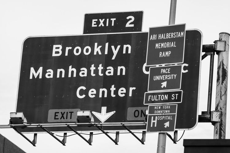 NY Text Western Script Communication Information Sign No People Information Sign Day Guidance Script Capital Letter Non-western Script Advertisement Outdoors Board Placard Direction Low Angle View Food And Drink Nature