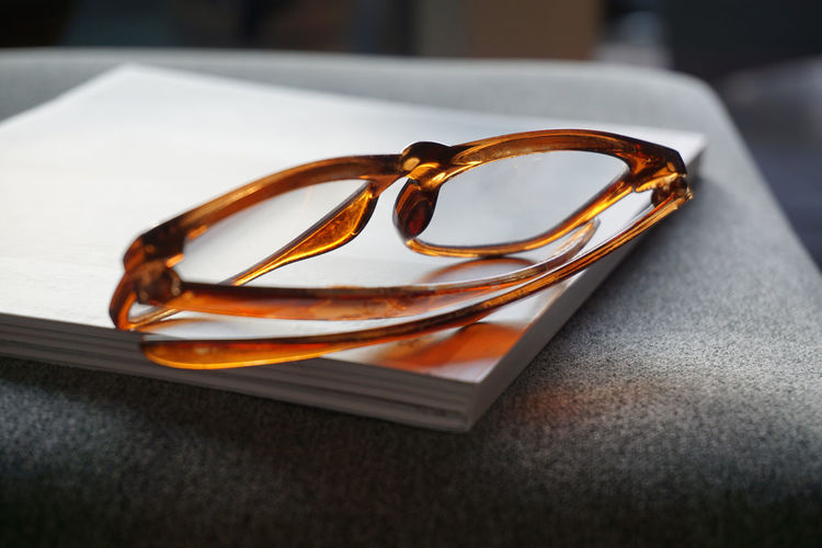 Diopter Home Reading Relaxing Brown Close-up Emotion Event Focus On Foreground Glasses Gold Colored Indoors  Love Luxury No People Personal Accessory Selective Focus Still Life Table Two Objects