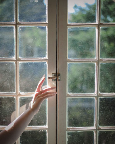 Close-up Day Door Glass - Material Human Body Part Human Finger Human Hand Indoors  Looking Through Window One Person People Real People Window