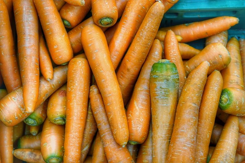 Healthy Eating Carrot Vegetable Root Vegetable Food And Drink Food Freshness Abundance Organic Large Group Of Objects Backgrounds Retail  Wellbeing Market Raw Food Market Stall Full Frame For Sale Orange Color No People
