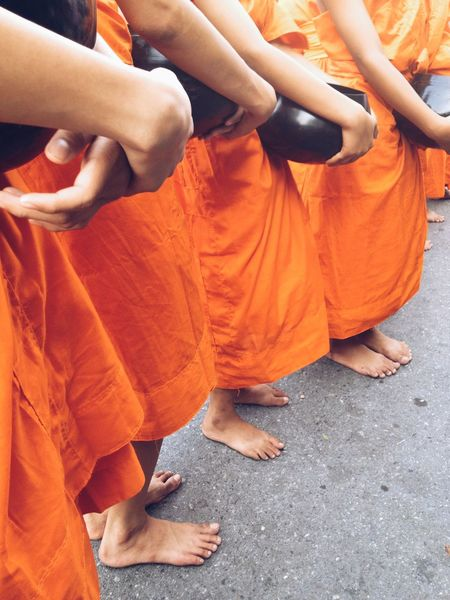 Food offering to a monk Ancient Buddha Monk Walk Thailand Tradition Traditional Culture Adult Barefoot Buddhism Culture And Tradition Cultures Day Human Body Part Human Hand Human Leg Lifestyles Low Section Men Monk  Monk Budhist Prayer Monk Robe Orange Color People Real People Religion