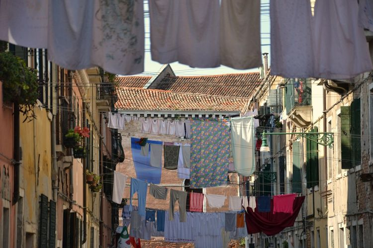 Low Angle View Of Buildings With Clothes Line
