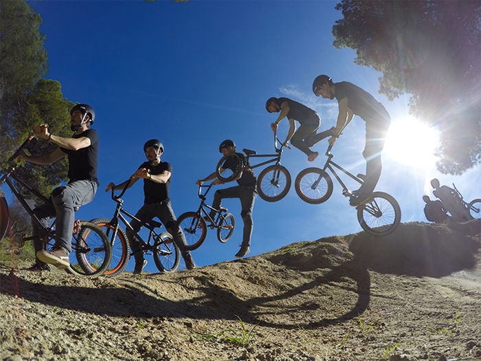BMX riders trying new things at a dirt bike field EyeEm Best Shots EyeEmNewHere Activity Bicycle Blue Cycling Day Full Length Group Of People Land Vehicle Leisure Activity Lens Flare Lifestyles Low Angle View Men Nature Outdoors People Real People Riding Sky Sport Sun Sunlight Transportation Go Higher The Great Outdoors - 2018 EyeEm Awards