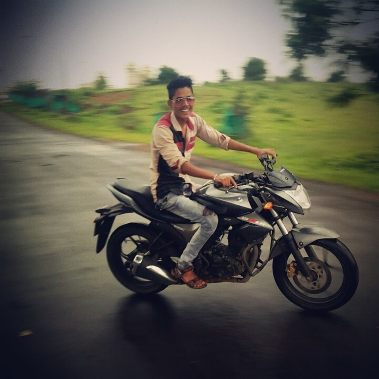 motorcycle, riding, transportation, real people, biker, one person, speed, full length, land vehicle, mode of transport, men, adventure, road, lifestyles, motion, motorcycle racing, helmet, outdoors, risk, day, motocross, young adult, sky, adult, people