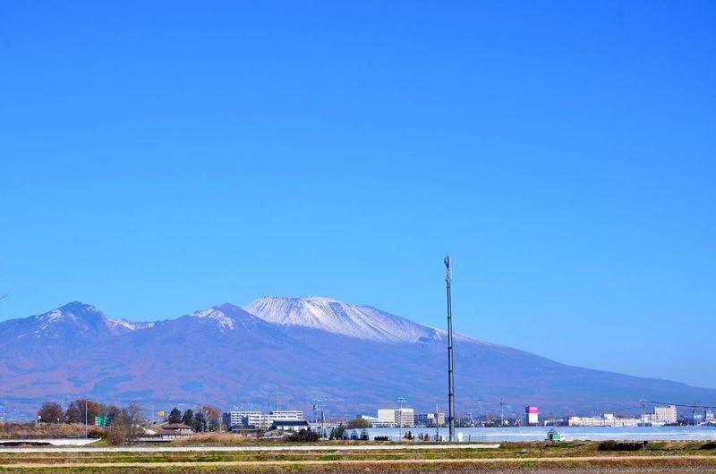 Mount asama against clear blue sky