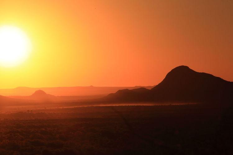 Africa Clear Sky Dust Idyllic Landscape Mountain Mountain Range Namibia Orange Color Scenics Silhouette Sun Sunlight Sunset Tranquil Scene The Great Outdoors - 2016 EyeEm Awards