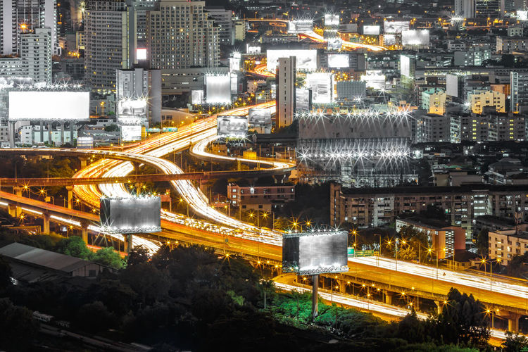 Aerial cityscape view of expressway or tollway at night