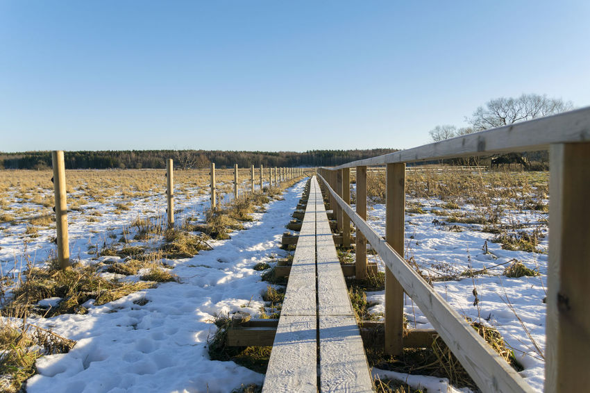 Beauty In Nature Clear Sky Cold Temperature Day Footbridge Footbridge Crossing Landscape Nature No People Outdoors Picket Fence Rural Scene Sky Snow Winter