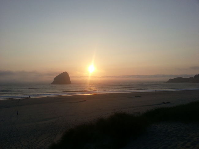 Sea Sunset Beach Horizon Over Water Water Reflection Beauty In Nature Nature Scenics Travel Destinations Silhouette Outdoors Tranquility Tranquil Scene No People Sand Landscape Refraction Sky Day Canon Beach Oregoncoast